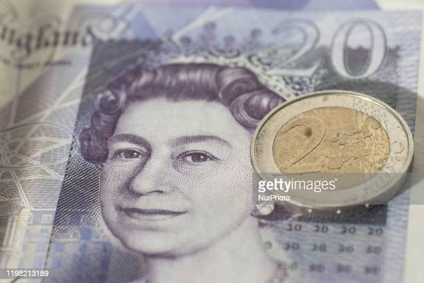 Currency exchange rate illustration photo mix of money Sterling / British Pound GBP and Euro EUR banknotes paper bills and coin at close up pictures...