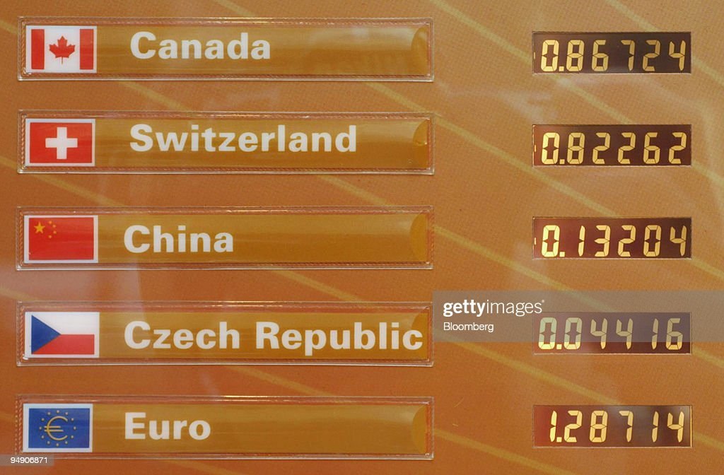 Currency exchange rates are pictured on a board outside an a