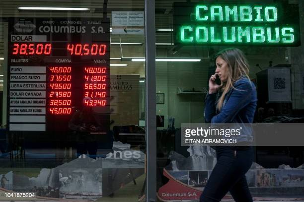 Currency exchange values are displayed on the buysell board of a bureau de exchange in Buenos Aires on September 27 2018 Argentina's peso dipped 23...