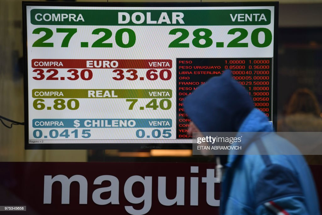 Currency exchange values are seen in the buy sell board of a bureau