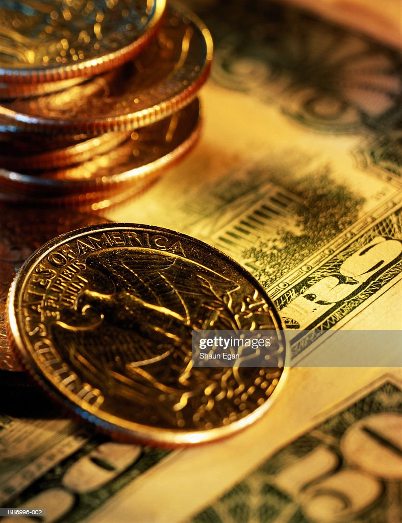 US currency, fifty dollar banknotes with quarter dollar coins, close-u : Stock Photo