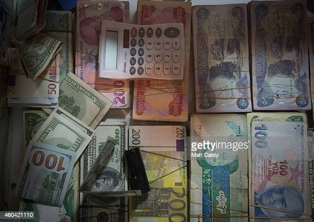 Currency is exchanged inside the Qaysari Bazaar on December 13 2014 in Erbil Iraq As insecurity continues throughout Iraq it was announced today by...