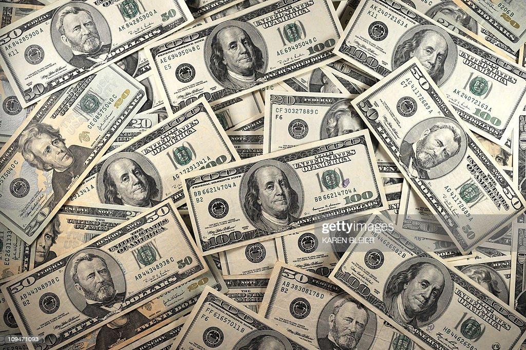 US Currency is seen in this January 30, 2001 image. AFP PHOTO/Karen BLEIER