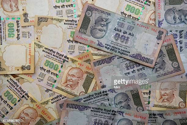 Currency notes of Indian one hundred rupee and five hundred rupees spread in New Delhi India