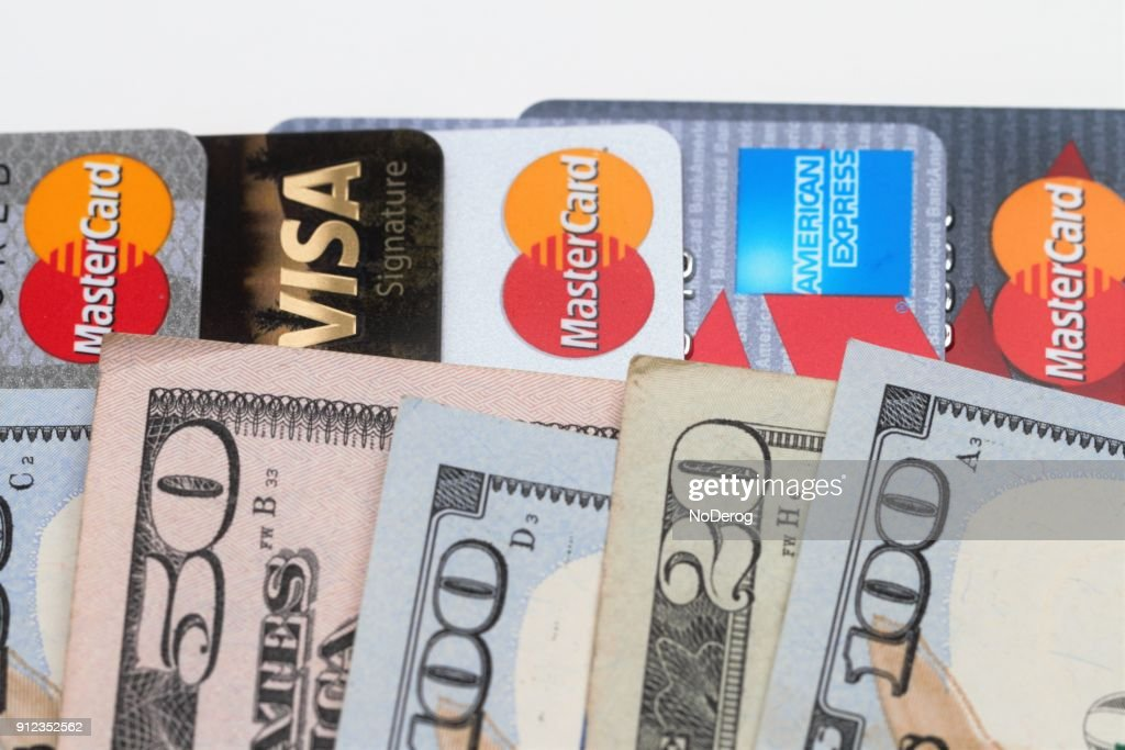 Usa Currency On Top Of A Row Various Credit Cards Stock Photo
