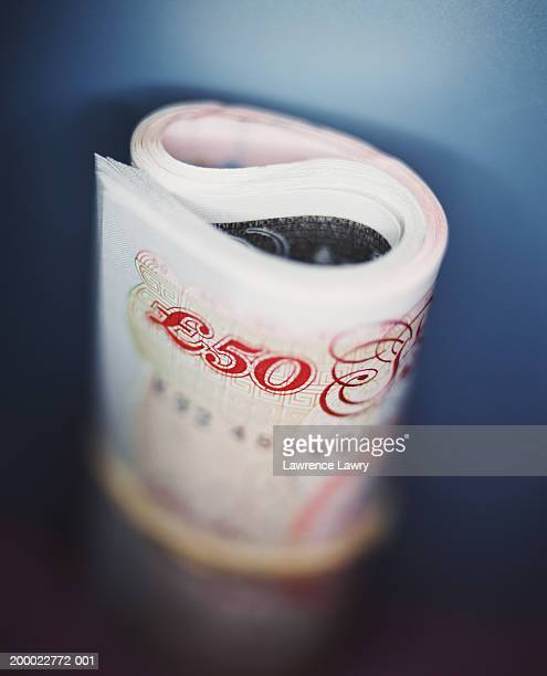 UK currency: roll of fifty pound notes, close-up