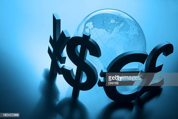 currency symbols surround globe on blue background - currency symbol stock pictures, royalty-free photos & images