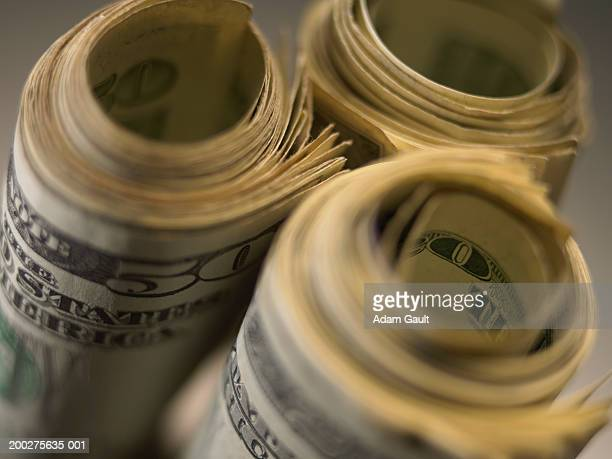 US Currency: Three rolls of US bills, close-up