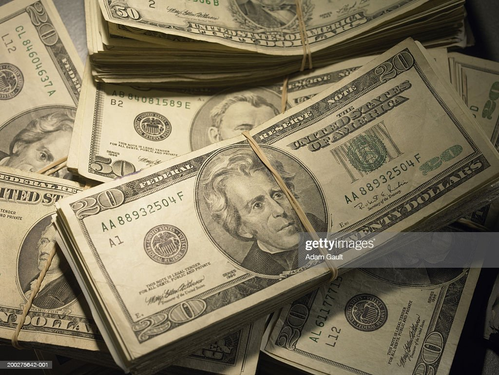 US Currency: Wads of US bills fastened with rubber bands, close-up : Stock Photo