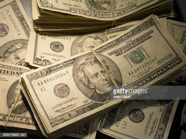 us currency: wads of us bills fastened with rubber bands, close-up - us currency stock pictures, royalty-free photos & images