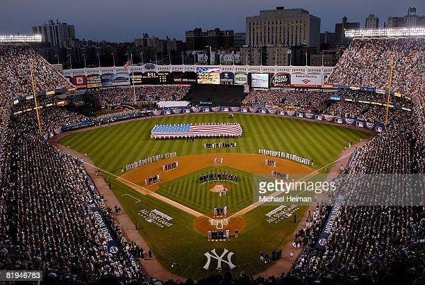 Current and former AllStars stand on the field during the National Anthem prior to start of the 79th MLB AllStar Game at Yankee Stadium on July 15...