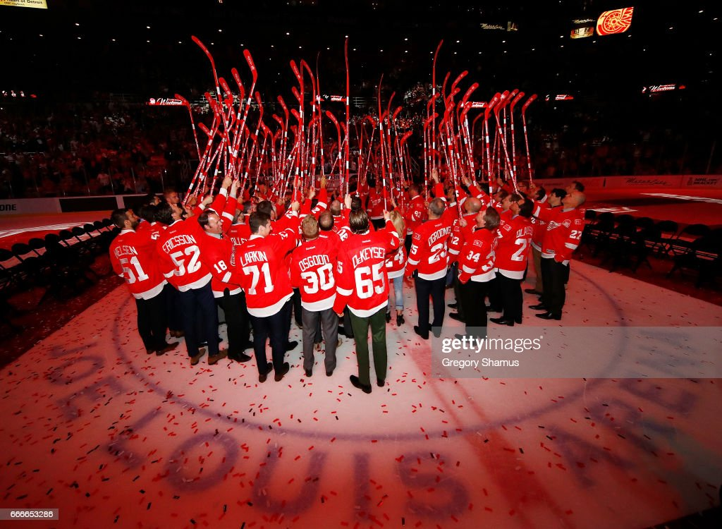 Current and former players of the Detroit Red Wings salute the fans at a ceremony honoring Joe Louis Arena on April 9, 2017 in Detroit, Michigan. The Detroit Red Wings beat the New Jersey Devils 4-1 in the last NHL game at the arena.