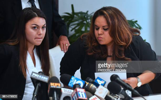 Current and former University of Southern California students Daniella Mohazab and Angela Esquivel Hawkins switch seats to speak at a press...