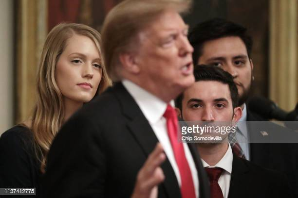 Current and former university students listen to US President Donald Trump deliver remarks before signing an executive order protecting freedom of...