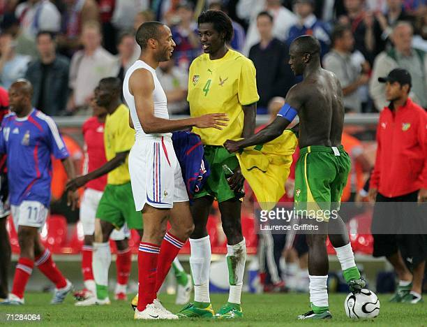 Current Arsenal captain Thierry Henry of France and Arsenal player Emmanuel Adebayor of Togo speak after the FIFA World Cup Germany 2006 Group G...