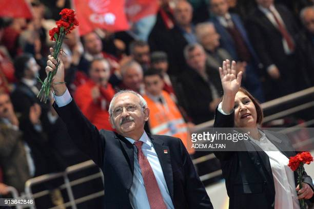 Current Chairman of Turkey's main opposition Republican People's Party , Kemal Kilicdaroglu and his wife Selvi Kilicdaroglu, greet people as they...