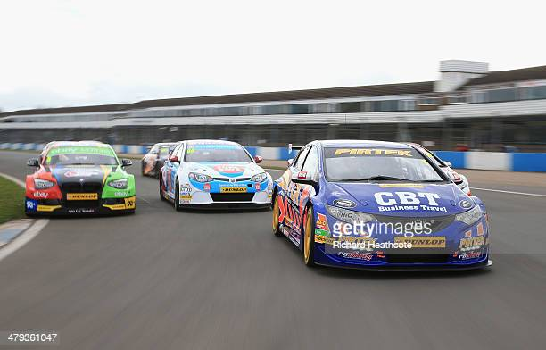 Current champion Andrew Jordan in his Pirtek Racing Honda Civic leads the pack around on a display lap during the 2014 Dunlop MSA British Touring Car...