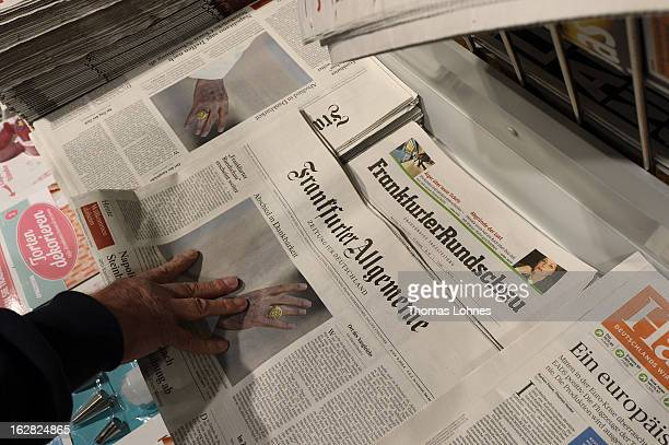 Current editions of the Frankfurter Allgemeine Zeitung and the Frankfurter Rundschau newspaper lying at a news stand on February 28 2013 in Frankfurt...