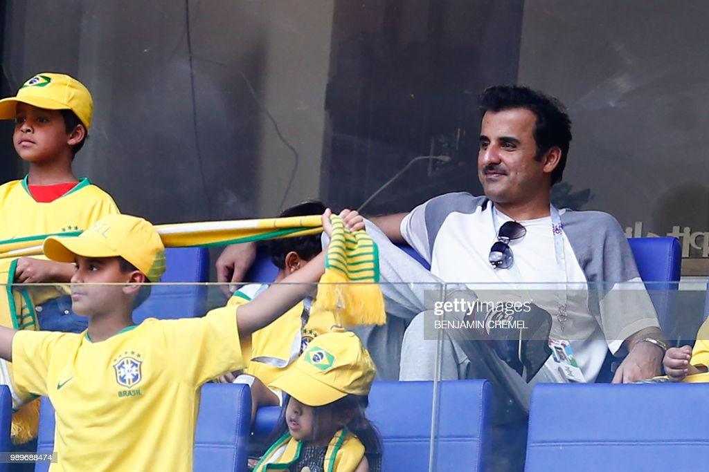Current Emir of Qatar, Sheikh Tamim bin Hamad Al Thani waits for the start of the Russia 2018 World Cup round of 16 football match between Brazil and Mexico at the Samara Arena in Samara on July 2, 2018. (Photo by BENJAMIN CREMEL / AFP) / RESTRICTED