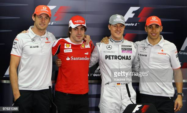 Current F1 World Champion Jenson Button of Great Britain and McLaren Mercedes appears with former champions Fernando Alonso of Spain and Ferrari,...