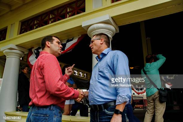 "Current Kansas Attorney General Derek Schmidt, left, meeting some of his supporters prior to his ""Stump ""speech during the Gubernatorial debate at..."