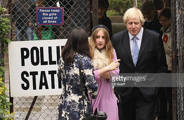 Current Mayor of London Boris Johnson , his wife Marina Johnson and his daughter Lara Johnson , leave a North London polling station after casting...