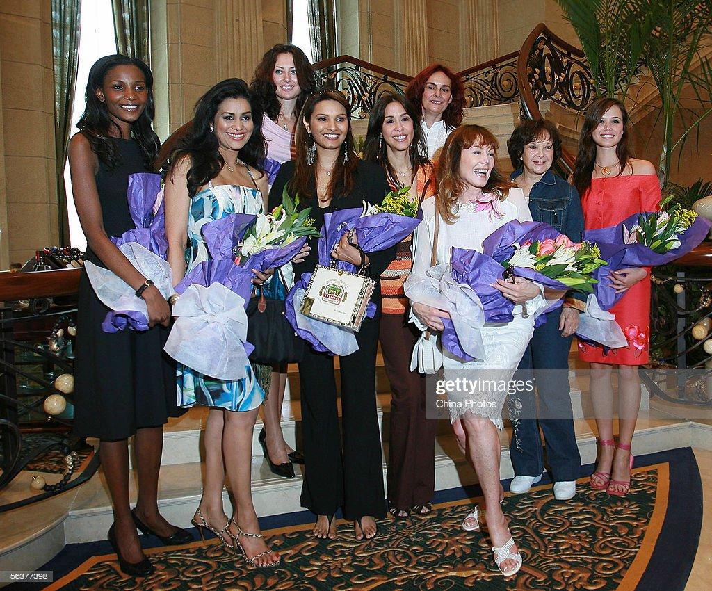 Current Miss World Maria Julia Mantilla Garcia (R) poses with former Miss Worlds (L-R) Agbani Darego, Miss World 2001, Wilnelia Merced, Miss World 1975, Julia Kurochkina, Miss World 1992, Diana Hayden, Miss World 1997, Mariasela Alvarez, Miss World 1982, Ann Sidney, Miss World 1964, Lucia Petterle, Miss World 1971, Denise Perrier Lanfranchi, Miss World 1953, who are now judges for this years Miss World pageant, on December 8, 2005 in Sanya, Hainan Island of China. The final of Miss World 2005 will be held in Sanya on December 10.