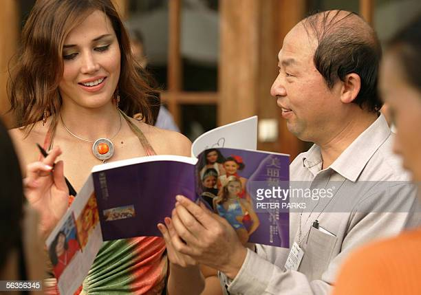 Current Miss World Maria Julia Mantilla Garcia signs an autograph for a local fan at the Sheraton Resort on the southern Chinese resort island of...