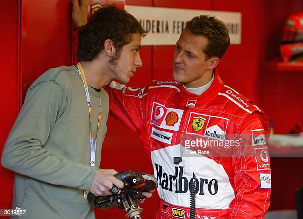 Current Moto GP World Champion Valentino Rossi talks with Michael Schumacher prior to the 2004 Australian Grand Prix which which is round one of the...