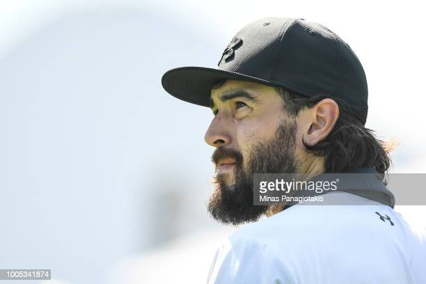 Current NHL hockey player with the Los Angeles Kings Drew Doughty looks on after hitting his tee shot from the seventh during the practice rounds at...