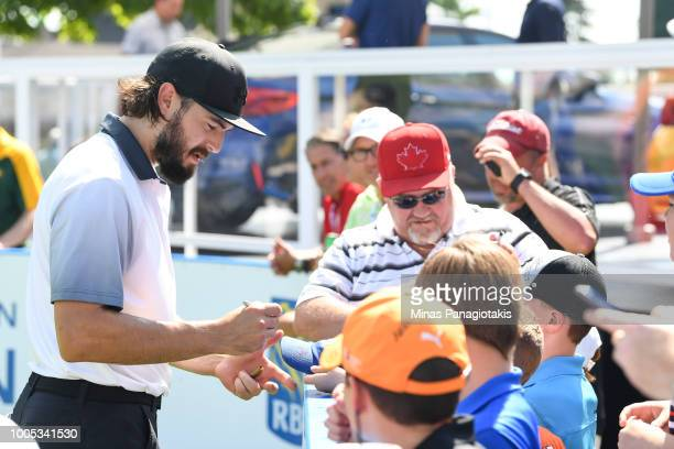 Current NHL hockey player with the Los Angeles Kings Drew Doughty signs autographs during the practice rounds at the RBC Canadian Open at Glen Abbey...