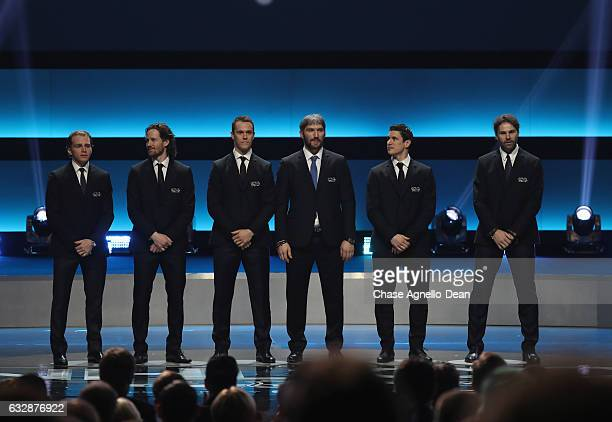 Current NHL players Patrick Kane Duncan Keith Jonathan Toews Alexander Ovechkin Sidney Crosby and Jaromir Jagr stand onstage during the NHL 100...