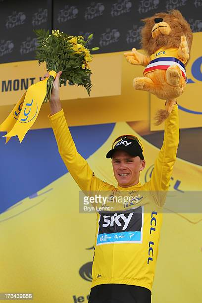 Current race leader and wearer of the Maillot Jaune Chris Froome of Great Britain and SKY Procycling celebrates on the podium after winning stage...