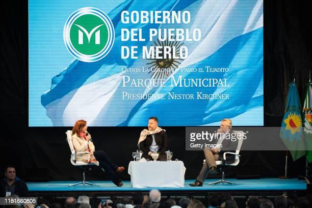 Current senator and former President Cristina Fernandez mayor of Merlo Gustavo Menéndez and candidate for president Alberto Fernandez gather over the...