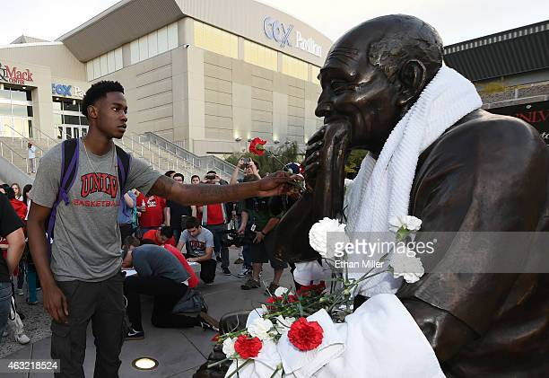 Current UNLV Rebels forward Dwayne Morgan puts a carnation on a statue of Jerry Tarkanian outside the Thomas Mack Center at UNLV during a gathering...