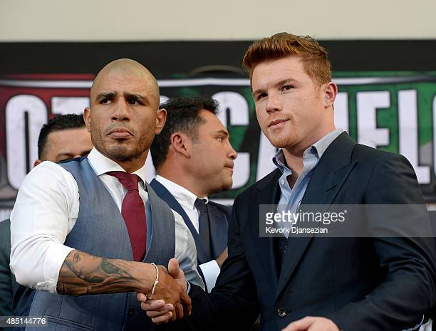Current WBC champion Miguel Cotto and contender Canelo Alvarez pose after a news conference to announce their upcoming bout on August 24 in Los...