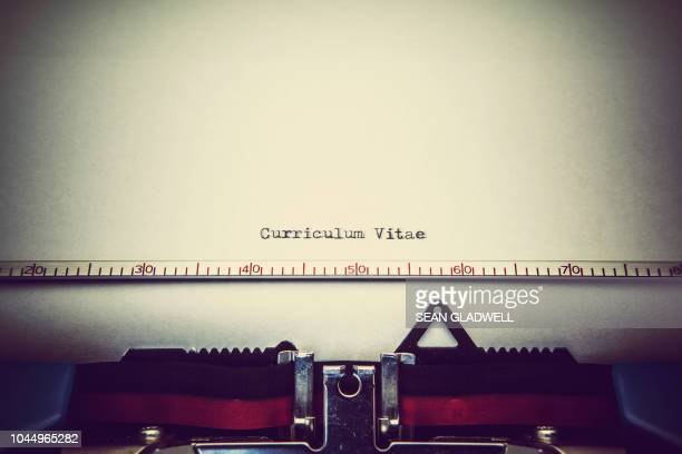 curriculum vitae typed on typewriter - resume stock photos and pictures