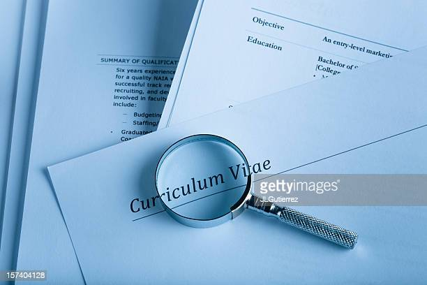 A curriculum vital and a magnifying glass