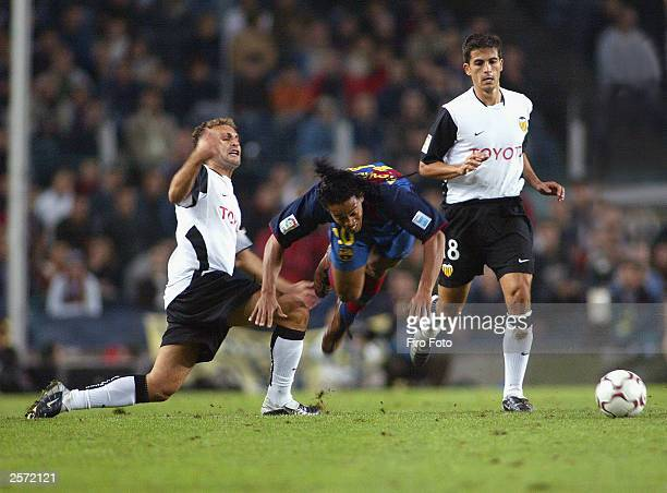 Curro Torres Ronaldinho and Jorge Lpez in action during the Spanish Primera Liga match between Barcelona and Valencia at the Camp Nou Stadium on...