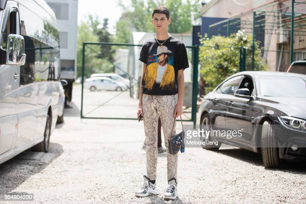 Curro Verdugo wears an Alan Jackson country singer tshirt white python leather pants a Christian Dior saddle bag with buttons and white Louis Vuitton...
