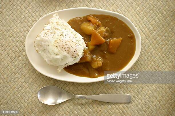 Curry and rice with a sunny-side-up egg