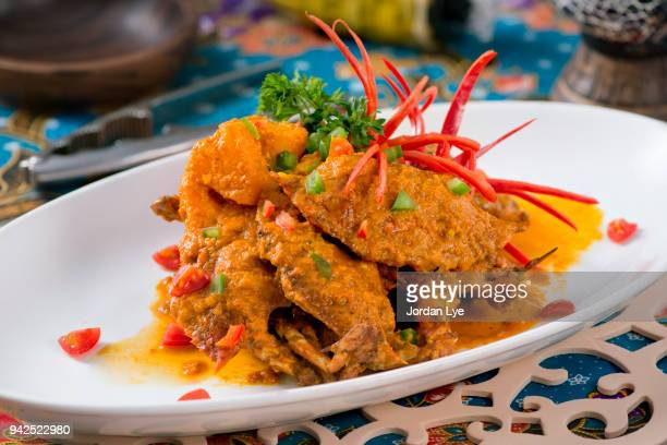 curry crab - chilli crab stock photos and pictures