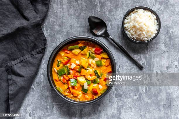 curry dish, sweet potato curry, sugar pea, paprika, zucchini, coconut milk, shrimps and rice - indian food stock pictures, royalty-free photos & images