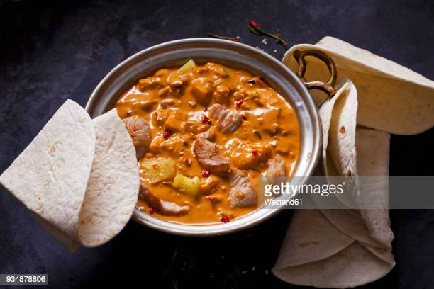 curry dish with turkey and pineapple in curry sauce - indian food stock photos and pictures