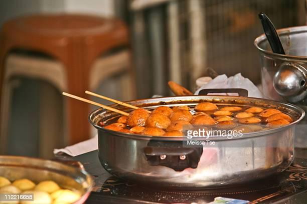 Curry fish balls -popular street food in Hong Kong