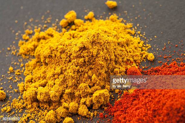 curry powder and chili pepper - curry powder stock photos and pictures