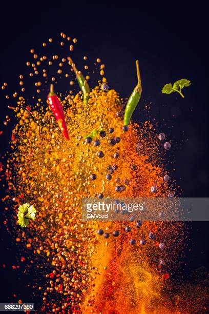 curry spice mix food explosion - spice stock pictures, royalty-free photos & images