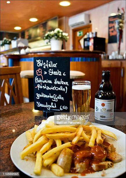Currywurst the typical north rhinewestphalia sausage is seen on a table with a glass of beer on February 13 2010 in Essen Germany