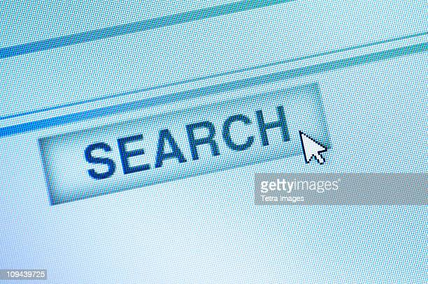 Curser by search icon on computer screen