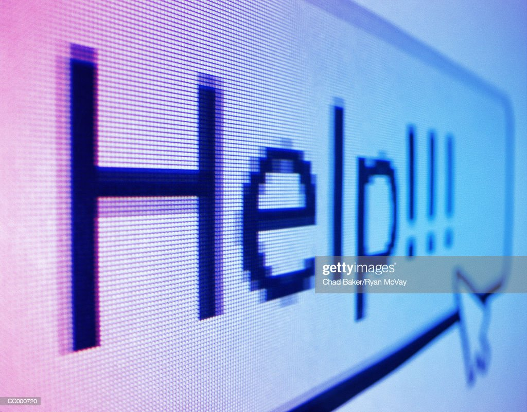 Cursor Pointing to Help on a Computer Screen : Stock Photo